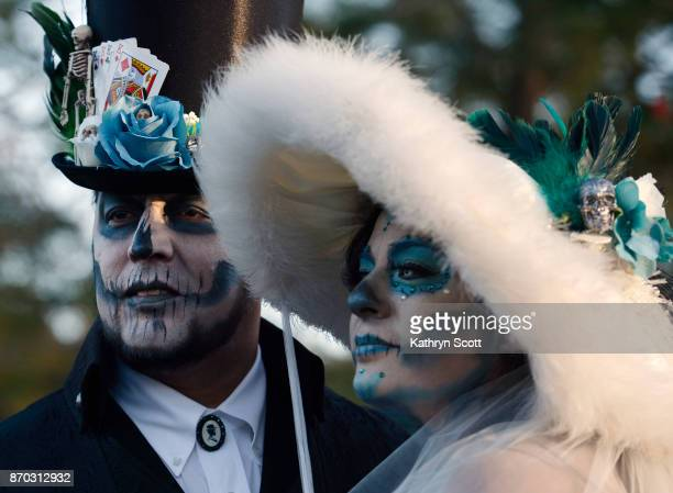 Bride and Groom Rosa Estrada and Carlos Cortes join a large crowd of visitors to the Denver Botanic Gardens to celebrate 'Dia de los Muertos' Day of...