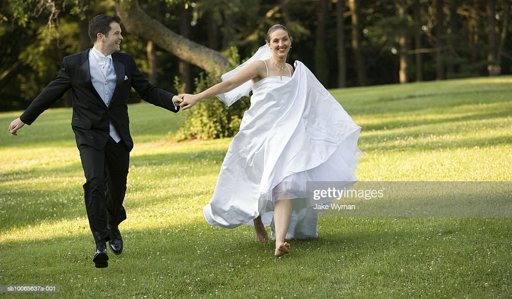 Marvelous Bride And Groom Running On Lawn Stock Foto Getty Images Download Free Architecture Designs Scobabritishbridgeorg