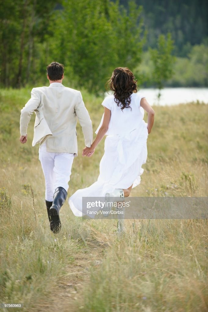 Amazing Bride And Groom Running Stock Photo Getty Images Download Free Architecture Designs Scobabritishbridgeorg