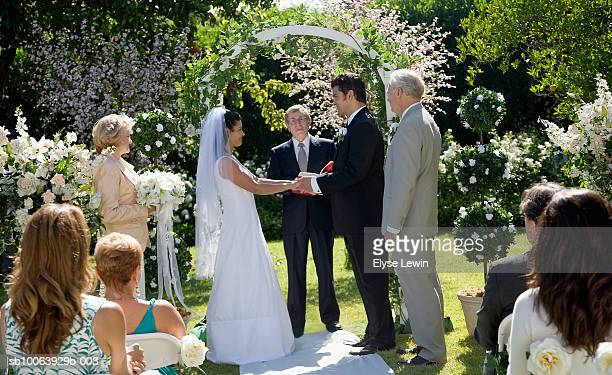 bride and groom saying vows at wedding - wedding ceremony stock photos and pictures