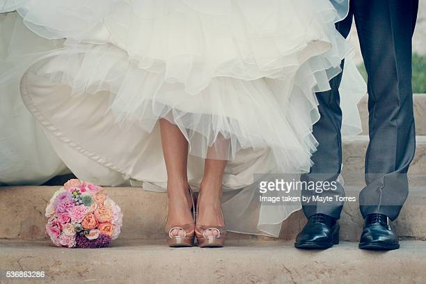 Bride and groom shoes in stairs