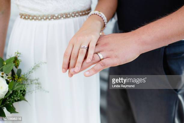 Bride and groom showing wedding rings