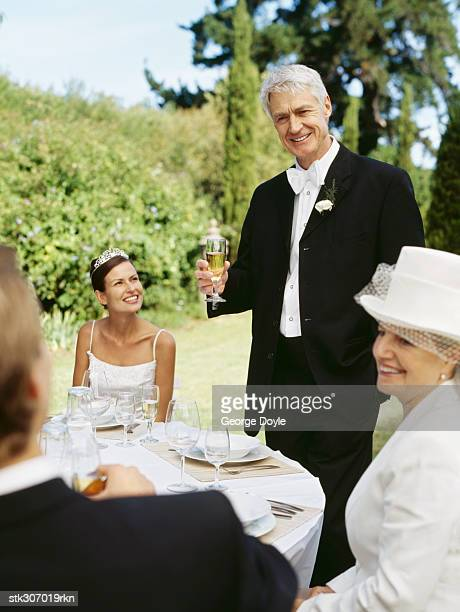 bride and groom sitting with their parents