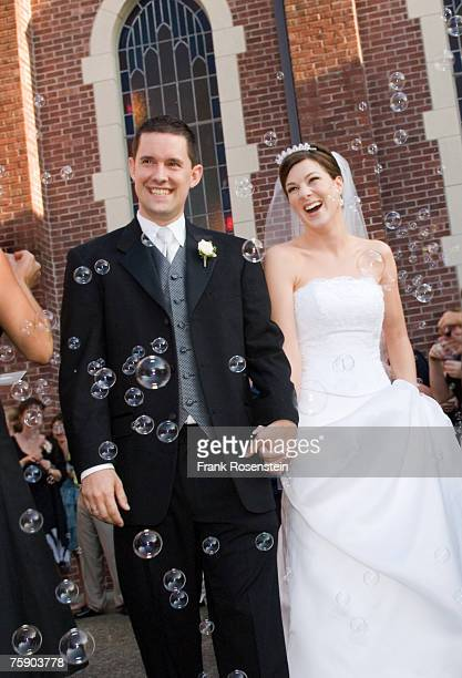 bride and groom smiling outside church, three quarter length - three quarter length ストックフォトと画像