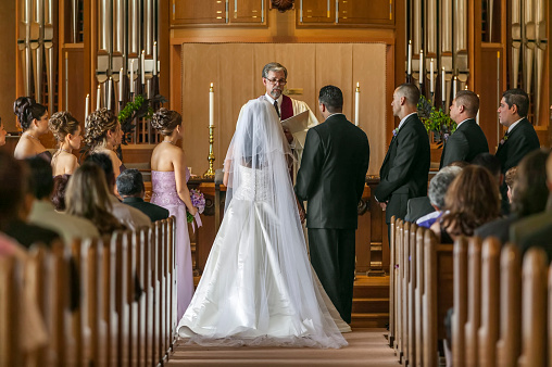 Bride and groom standing at altar during wedding ceremony - gettyimageskorea