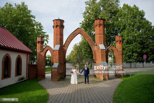 Bride And Groom Standing At Park