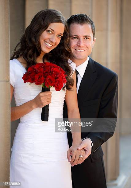 bride and groom standing outdoors - rich_legg stock photos and pictures