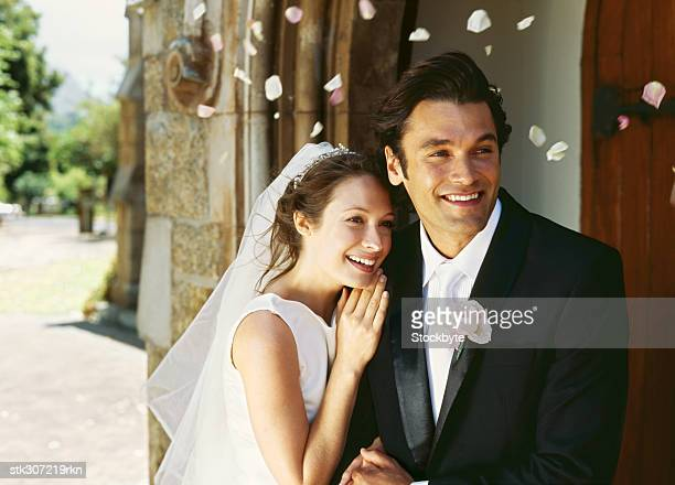bride and groom standing together - church wedding decorations stock pictures, royalty-free photos & images