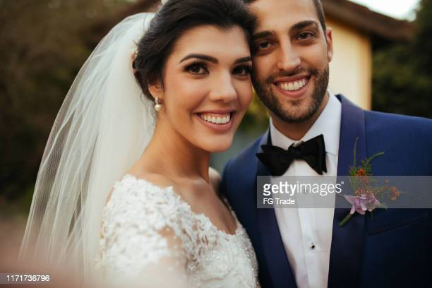 bride and groom taking a selfie at wedding day - groom stock pictures, royalty-free photos & images