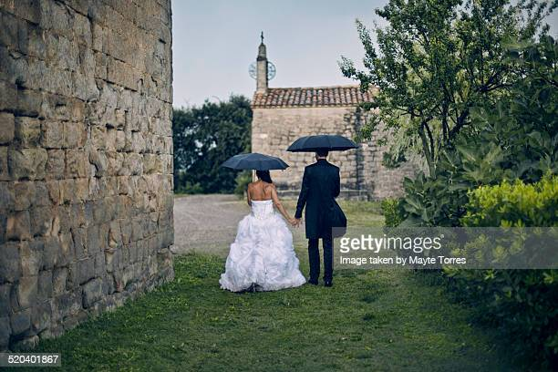Bride and groom under the rain