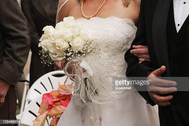 bride and groom walking down the aisle - wedding role stock photos and pictures