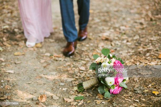 Bride and groom walking in forest