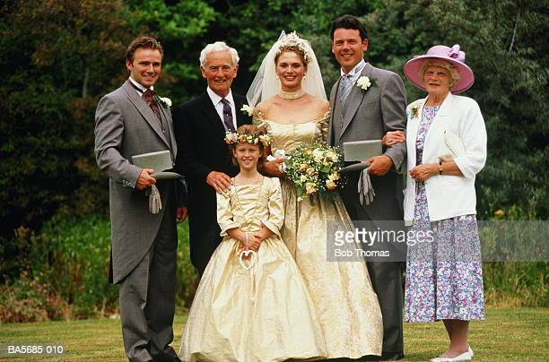 bride and groom with bridesmaid, best man and parents, portrait - wedding guest stock pictures, royalty-free photos & images