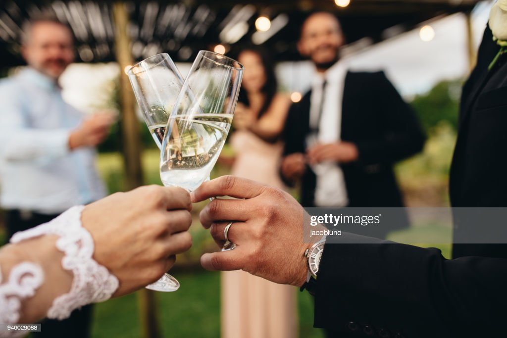 Bride and groom with glasses of champagne : Stock Photo