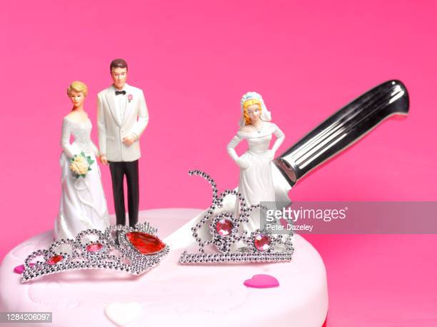 bride and groom with knife cutting between them and 2nd bride - bigamy stock pictures, royalty-free photos & images