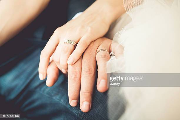 bride and groom's hands - wedding ring stock pictures, royalty-free photos & images