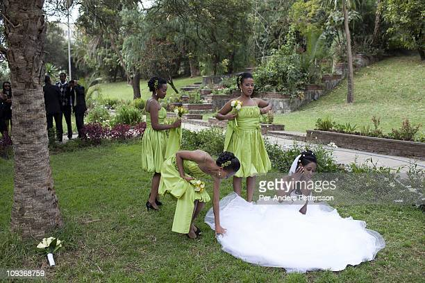 A bride and her bridesmaids prepare to poses for a wedding photographer in a park at Ghion Hotel on November 13 2010 in Addis Ababa Ethiopia The...