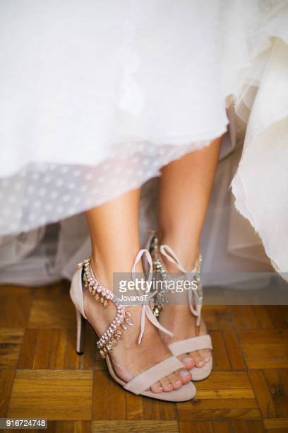 Bride and her cream coloured jewelry high heels