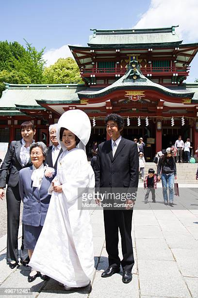 Bride and her family at a Japanese wedding in the Kabuto Shrine in Nihombashi, Tokyo.