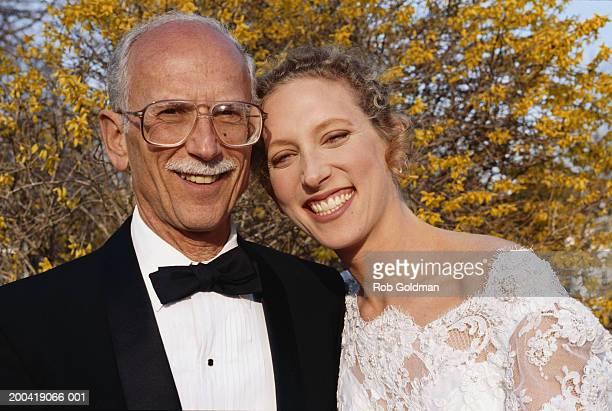 Bride and senior father, portrait