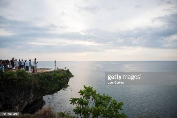 Bride and tourists at Balangan Beach, Bali