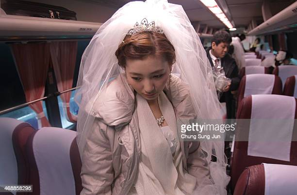 A bride arrives for her wedding ceremony at Cheongshim Peace World Center on February 12 2014 in Gapyeonggun South Korea 2500 couples from around the...