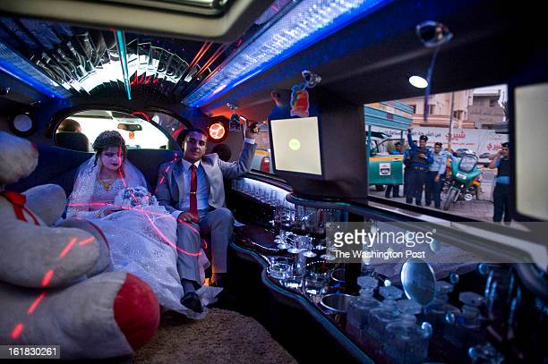 Bride Aseel Hamza L and groom Ahmed Abdul Kareem receive cheers from security officers as the sleek white Hummer 2 limo rolled past a security...