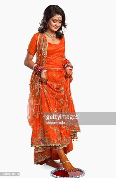bride at griha pravesh ceremony - indian female feet stock pictures, royalty-free photos & images