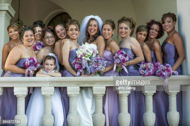 Bride, bridesmaids and flower girls smiling