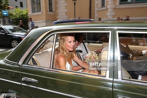 Bride Carina Wanzung arrives to her wedding of Mario Gomez and Carina Wanzungat registry office Mandlstrasse on July 22 2016 in Munich Germany