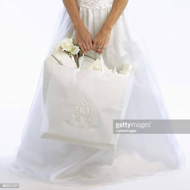 Bride carrying bag of gifts