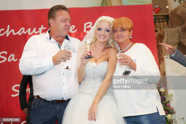 Bride Cathy Schmitz clinks glasses with her family at Lugner City on September 13 2014 in Vienna Austria