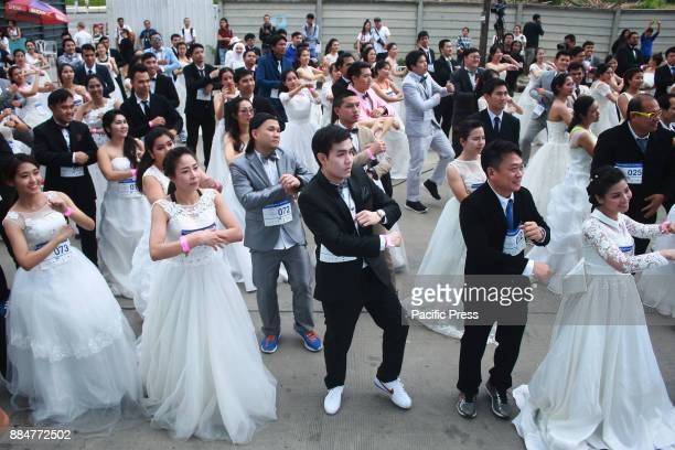 Bride compete in the ' Running of the Brides' in front of a department store in the shopping district of SHOW DC in Bangkok on December 2 during...