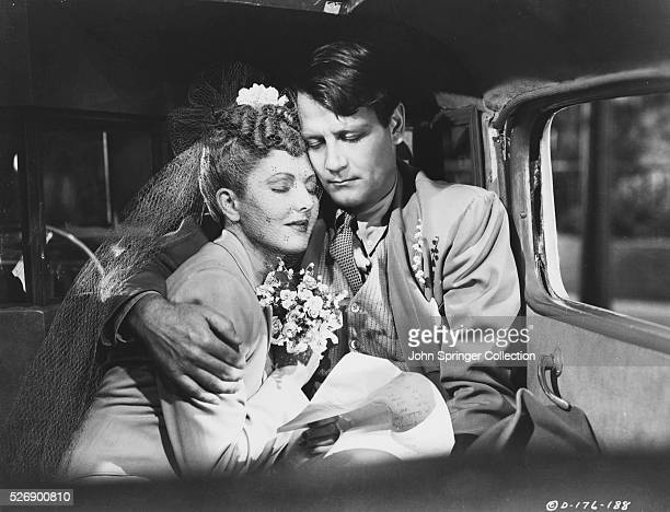 Bride Connie Milligan with her groom Joe Carter in a scene from the 1943 film The More the Merrier