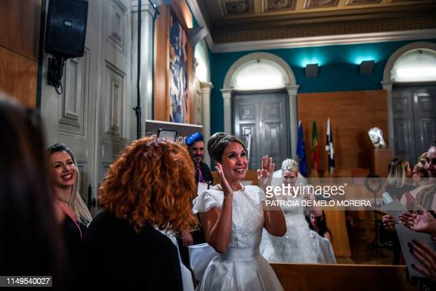 A bride cries with joy before celebrating a multiple wedding ceremony in Lisbon during Saint Anthony's day on June 12 2019 It is Lisbon's wedding of...