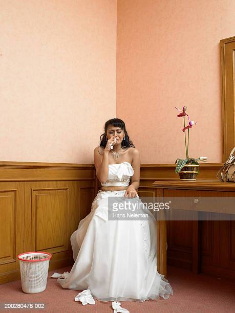 Bride crying in corner of room