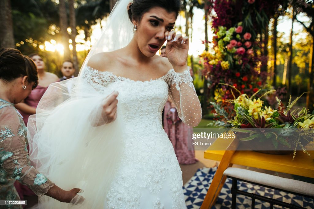 Bride crying in the altar : Stock Photo
