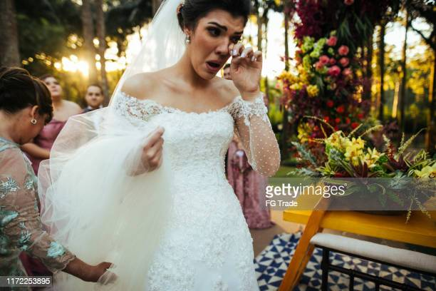 bride crying in the altar - groom stock pictures, royalty-free photos & images