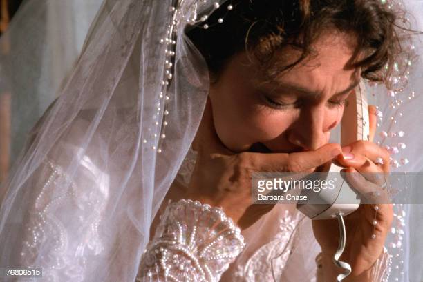Bride crying on telephone