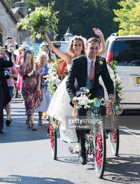 Bride Daisy Jenks and Charlie Van Straubenzee leave following their wedding on August 4, 2018 in Frensham, United Kingdom. Prince Harry attended the...