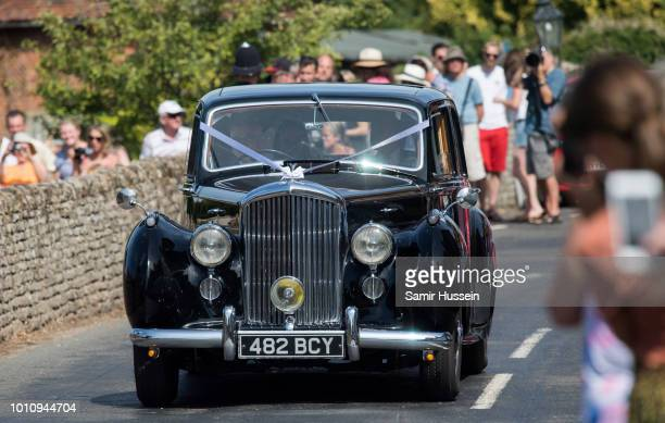 Bride Daisy Jenks arrives by car at the wedding of Charlie Van Straubenzee on August 4 2018 in Frensham United Kingdom Prince Harry attended the same...