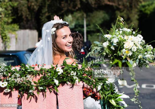 Bride Daisy Jenks leaves following her marriage to Charlie Van Straubenzee on August 4, 2018 in Frensham, United Kingdom. Prince Harry attended the...