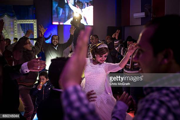 A bride dances during a traditional Egyptian wedding party on December 18 2016 in Cairo Egypt Since the 2011 Arab Spring Egyptians have been facing a...