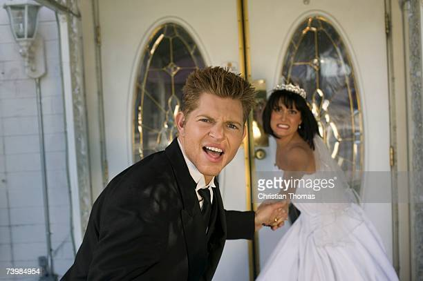 bride dragging groom into a wedding chapel - dragging stock pictures, royalty-free photos & images