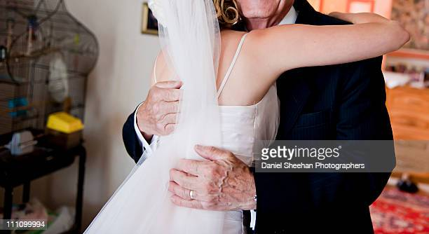 bride embracing father - spaghetti straps stock pictures, royalty-free photos & images