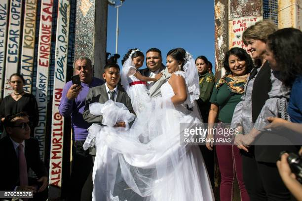 TOPSHOT Bride Evelia Reyes and groom Brian Houston living on different sides of the USMexico border stand for a family portrait after getting married...