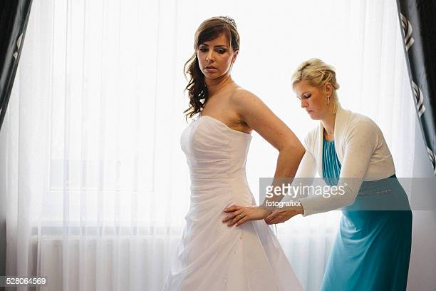 Bride gets help for lacing the corset