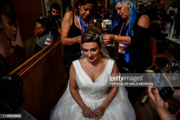 A bride gets ready for her marriage before celebrating a multiple wedding ceremony in Lisbon during Saint Anthony's day on June 12 2019 It is...