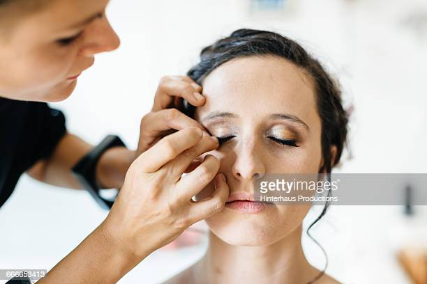 bride getting make-up applied - false eyelash stock pictures, royalty-free photos & images