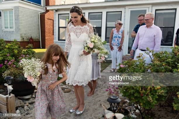 """bride getting out of beach house for small wedding. - """"martine doucet"""" or martinedoucet stock pictures, royalty-free photos & images"""